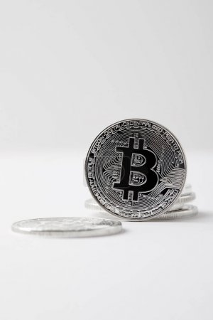 close-up shot of bitcoin standing on white tabletop