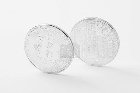 close-up shot of bitcoins on white surface
