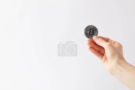 cropped shot of woman holding bitcoin isolated on white