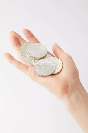 cropped shot of woman holding pile of bitcoins isolated on white