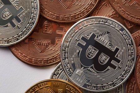 full frame shot of various bitcoins on white surface