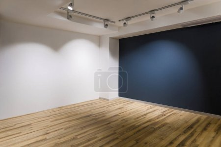 Photo for Empty room with dark and white walls and wooden floor - Royalty Free Image