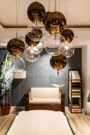Decorative modern chandelier over table in modern room