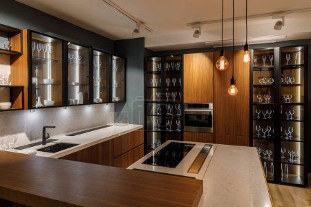 Interior of modern kitchen with glass cabinets and decorative bulbs