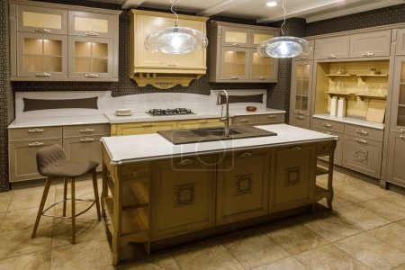 Interior of modern kitchen with beige cabinets