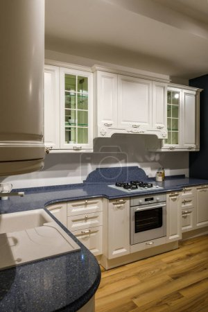 Photo for Renovated kitchen interior with white cabinets - Royalty Free Image