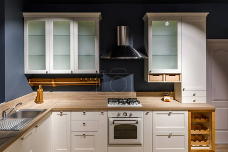 Photo for Stylish kitchen with vintage cabinets and stove - Royalty Free Image
