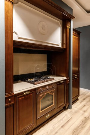 Stylish kitchen with elegant wooden counter and stove