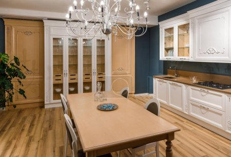 Renovated kitchen interior with chandelier over table