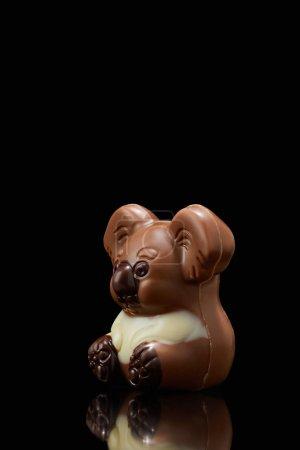 Photo for Closeup shot of koala shaped chocolate on black background - Royalty Free Image