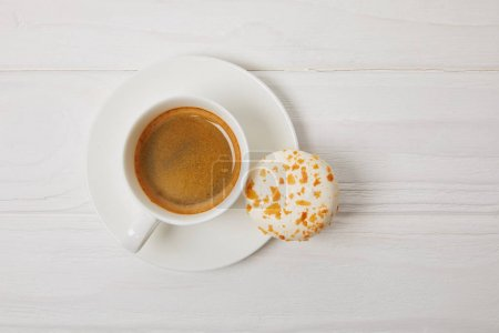 Photo for Top view of macaroon and coffee cup on white wooden table - Royalty Free Image