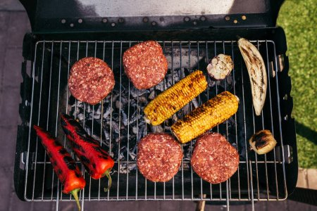 Meat chops and vegetables grilled for outdoors barbecue