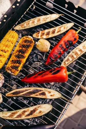 Corn and peppers cooked outdoors on grill