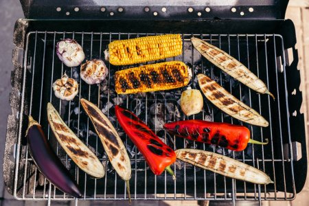 Summer seasonal vegetables cooked outdoors on grill