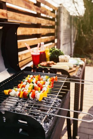 Summer vegetables and mushrooms on skewers grilled for outdoors barbecue