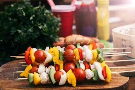 Vegetables on skewers with mushrooms cooked outdoors
