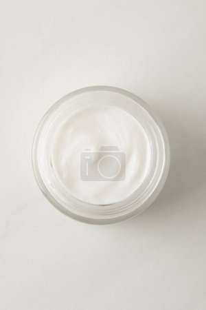 top view of organic cream in container on white background
