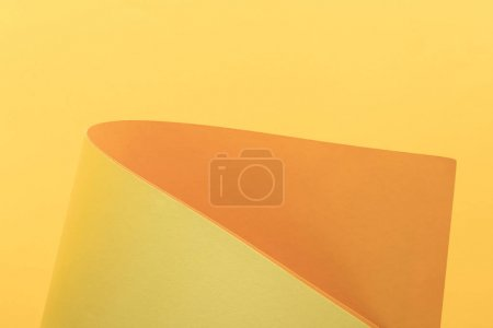 close-up view of bright yellow and orange paper background