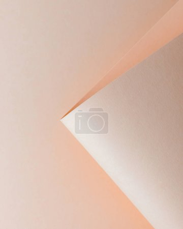 close-up view of tender beige paper sheet, abstract background