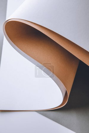 close-up view of blank white, brown and grey paper sheets, abstract background
