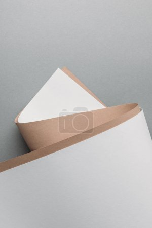 blank white and brown paper sheets on grey background