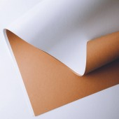 close-up view of white and brown paper sheets on grey background