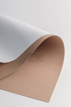 decorative white and brown paper sheets on grey background
