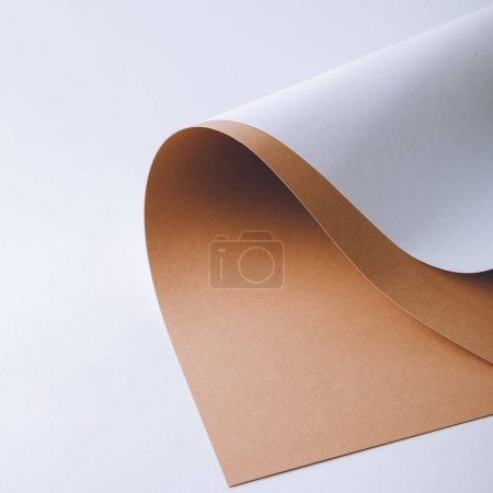 Photo for Close-up view of white and brown paper sheets on grey background - Royalty Free Image