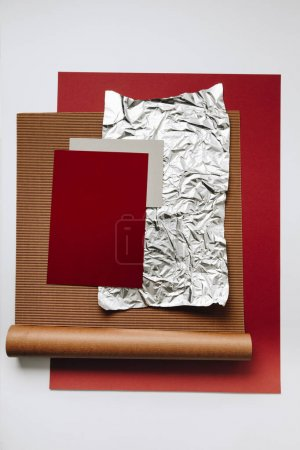 various blank paper, foil and cardboard textures on grey background