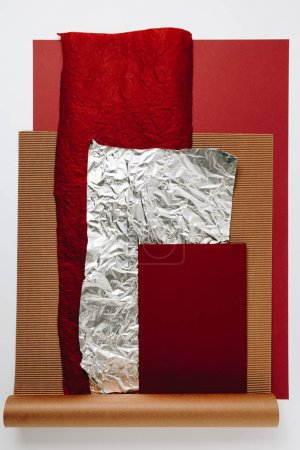 various paper, foil and cardboard textures on grey background