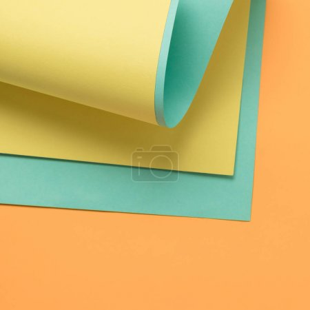 beautiful creative background with yellow, green and orange colored paper