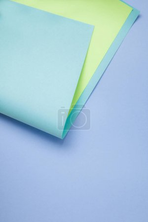 tender creative background with blue and green colored paper