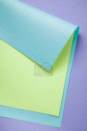 creative abstract background with blue, green and purple colored paper
