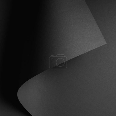 Photo for Dark abstract background with black rolled paper sheet - Royalty Free Image