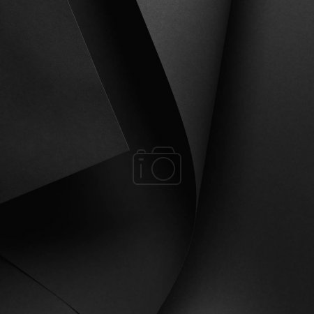 close-up view of dark paper sheet and black background