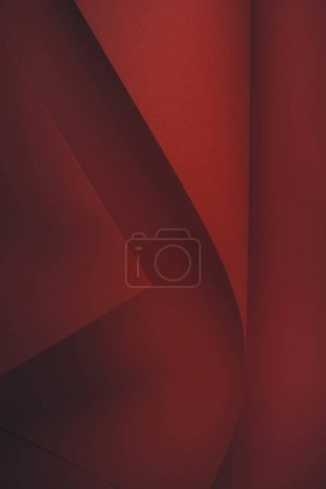 close-up view of dark red abstract paper background