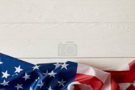 Photo for Top view of american flag on white wooden surface - Royalty Free Image