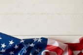 top view of american flag on white wooden surface