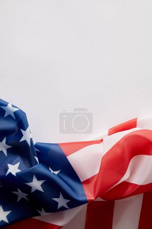 top view of united states of america flag on white surface