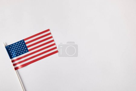 top view of united states of america flagpole on white surface