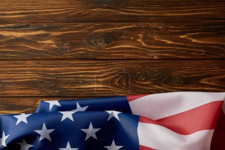top view of usa flag on wooden surface