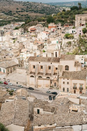 Photo for SCICLI, ITALY - OCTOBER 3, 2019: old italian city with small houses near green trees - Royalty Free Image