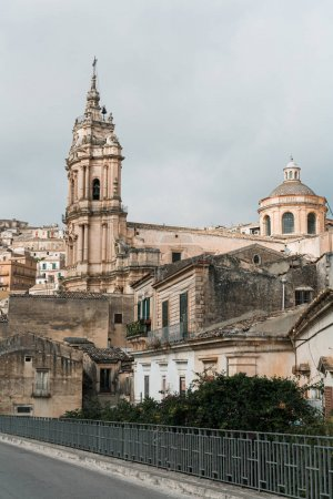 Photo for MODICA, ITALY - OCTOBER 3, 2019: baroque cathedral of san giorgio near houses in sicily - Royalty Free Image