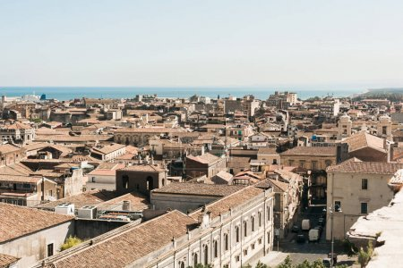 Photo for Sunlight on brown roofs of old houses near sea in catania, italy - Royalty Free Image