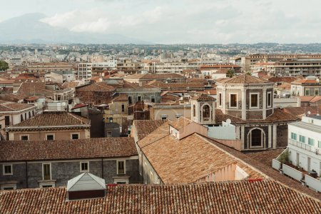 Photo for Sunshine on roofs of small old houses in catania, italy - Royalty Free Image