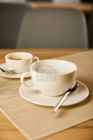 Photo for Selective focus of hot coffee in white cups - Royalty Free Image