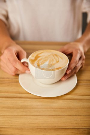 Photo for Cropped view of woman holding cup with cappuccino - Royalty Free Image