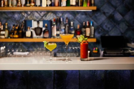 fresh and cold cocktails in glasses on bar stand