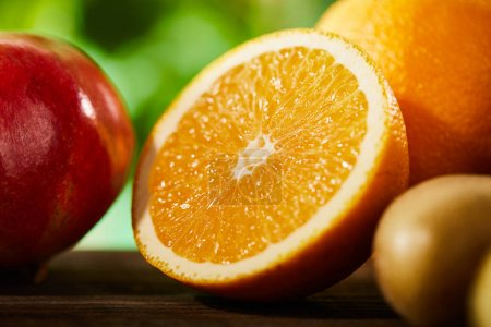 Photo for Close up view of cut and whole oranges, pomegranate and kiwi - Royalty Free Image
