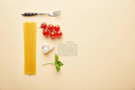 Photo for Flat lay with delicious spaghetti with tomato sauce ingredients on yellow background - Royalty Free Image